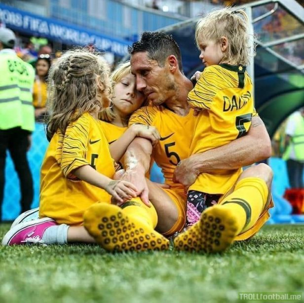 mark-milligan-from-australia-sits-on-grass-and-cries-when.jpg